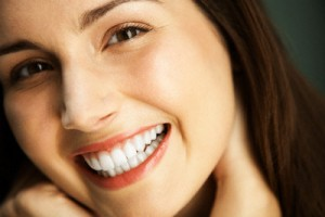Woman Smiling --- Image by © Mina Chapman/Corbis