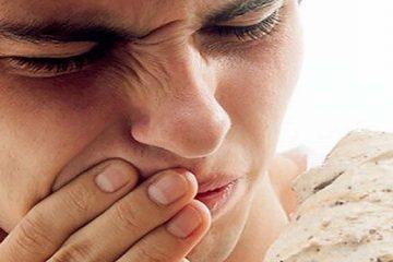 Bị ê buốt răng cửa hàm dưới là biểu hiện của bệnh gì?